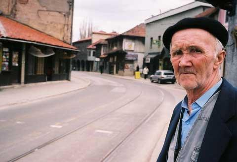 http://www.un.org/sites/www.un.org/files/styles/large/public/2016/01/07/elderly-man-waits-tram-sarajevo-bosnia-and-herzegovina.jpg